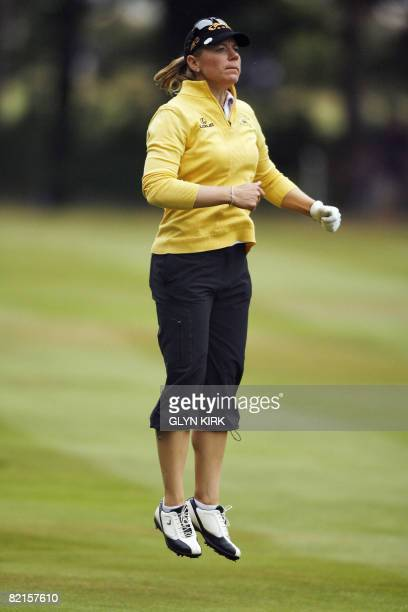 Swedish golfer Annika Sorenstam jumps to see if the green is clear on the 14th hole during the third round of the Ricoh Women's British Open...