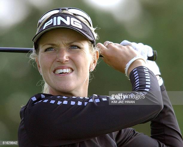 Swedish golfer Carin Koch eyes a ball on the 18th hole of the LPGA Nine Bridges Classic in Jeju Island 31 October 2004 Korean golfer Grace Park won...