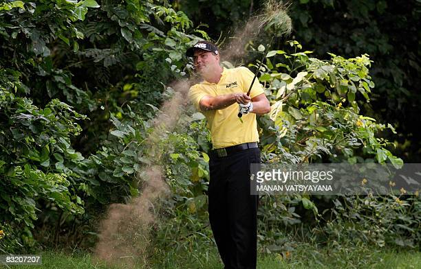 Swedish golfer Daniel Chopra plays a shot from the rough towards the fourth green during the second round of the Hero Honda Indian Open at the Delhi...