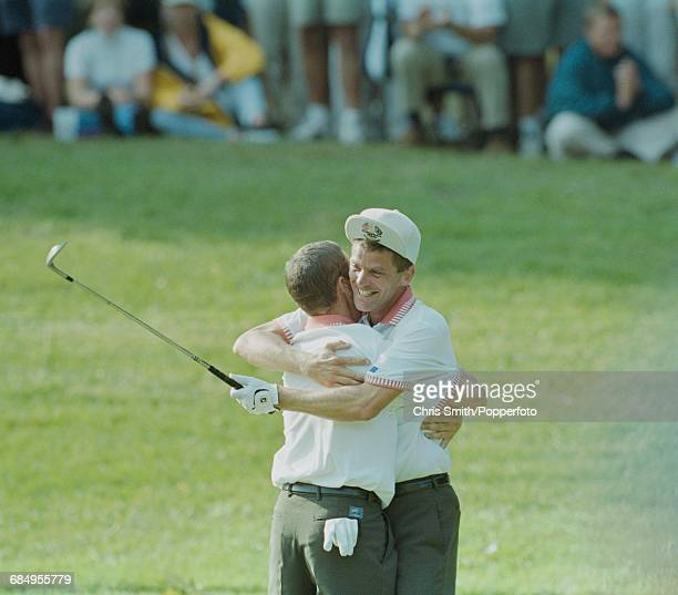 Swedish golfer Jesper Parnevik pictured right embracing his playing partner Spanish golfer Sergio Garcia after gaining points in action for Team...