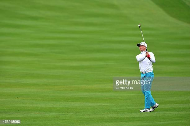 Swedish golfer Jonas Blixt plays his approach shot to the 1st green in his match against US golfer Patrick Reed during the first day of World Match...