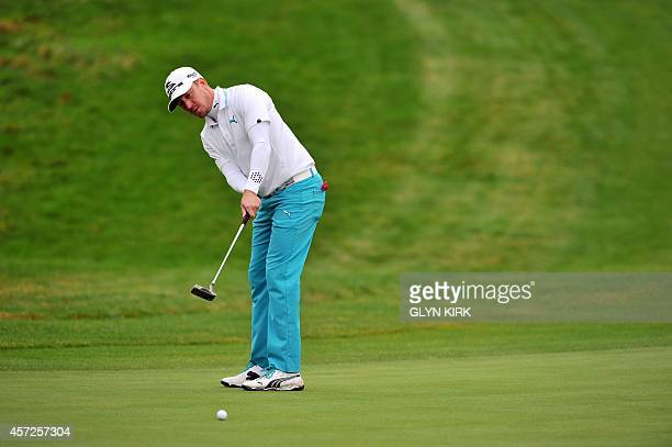 Swedish golfer Jonas Blixt putts on the 13th green in his match against US golfer Patrick Reed during the first day of the group stage matches in the...