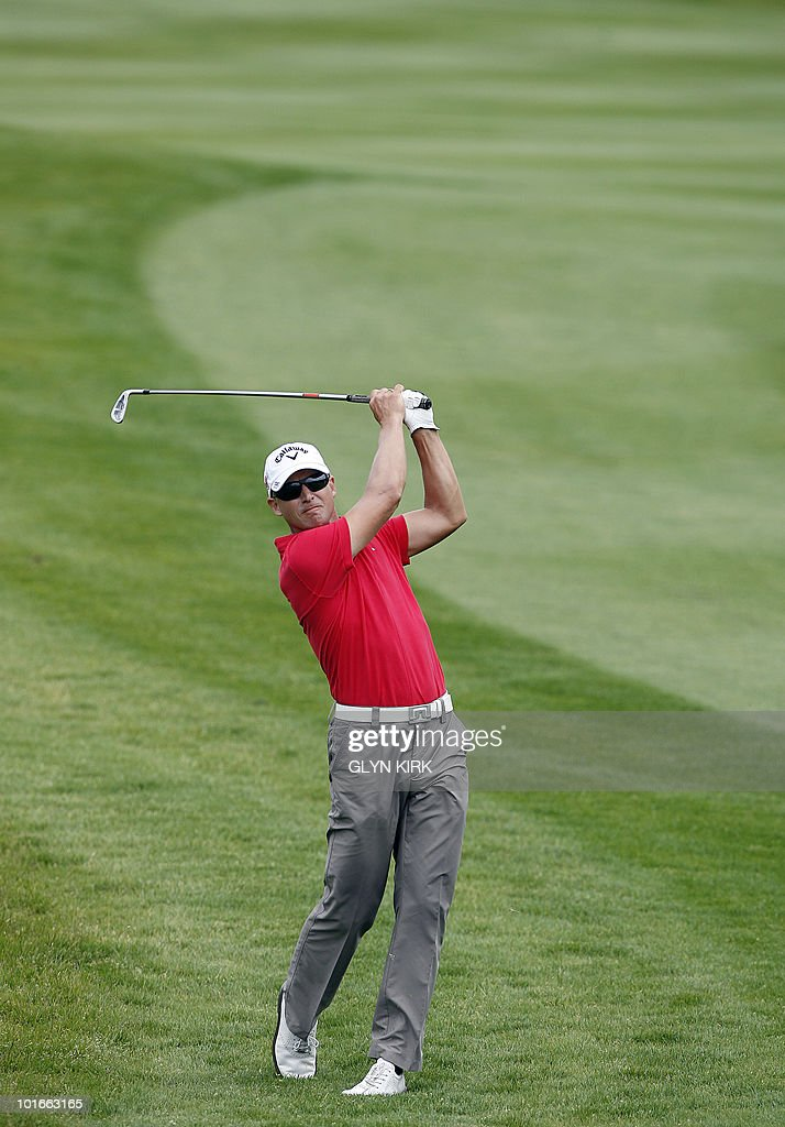 Swedish golfer Niclas Fasth watches his approach shot to the 4th green during the final round of the Celtic Manor Wales Open on The Twenty Ten Course in Newport, Wales on June 6, 2010.