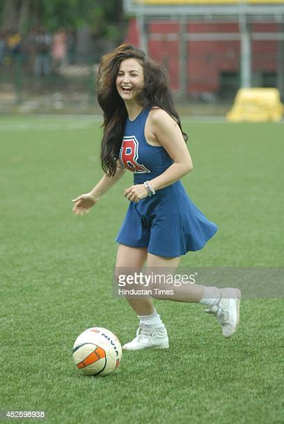 Swedish Greek actress Elli Avram shows her skills with the ball during the celebrity football match organized by Aamir Khan's daughter Ira Khan at...
