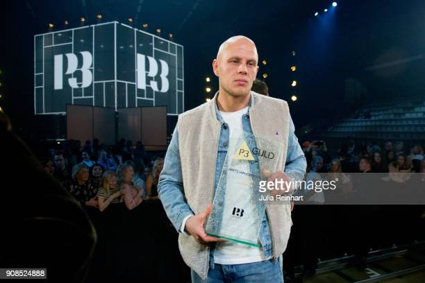 Swedish Hip Hopper Mwuana winner of the Hip Hop /RB Artist of the Year award shows off his prize at the P3 Guld Gala Swedish Radio's celebration of...