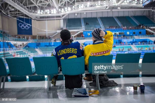 Swedish hockey fans remain in their chairs in a nearempty stadium following Sweden's loss to Switzerland in their Women's Ice Hockey Preliminary...