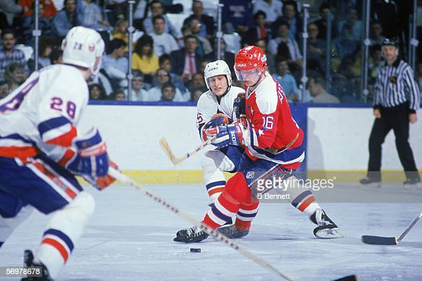 Swedish hockey player Bengt Gustafsson of the Washington Capitals struggles with Czech player David Volek of the New York Islanders during a game at...