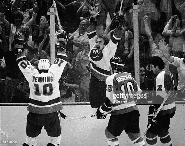 Swedish hockey player Bobby Nystrom forward for the New York Islanders leaps in the air aftering scoring the winning goal in overtime against the...