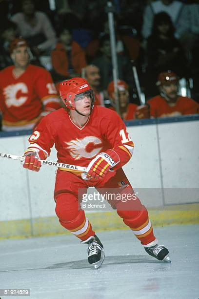 Swedish hockey player Hakan Loob forward for the Calgary Flames in action against the New York Islanders at Nassau Coliseum Uniondale New York mid...