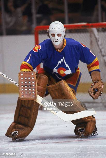 Swedish hockey player Hardy Astrom gaolkeeper for the Colorado Rockies gets ready for a shot during a road game late 1979 or early 1980