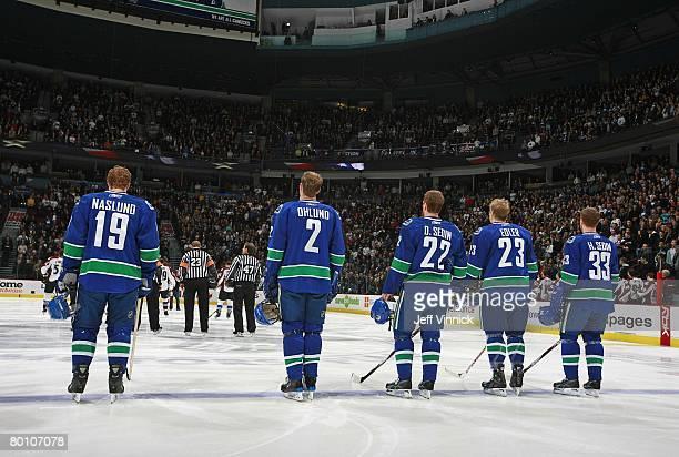 Swedish hockey players Markus Naslund Mattias Ohlund Daniel Sedin Alexander Edler and Henrik Sedin of the Vancouver Canucks listen to the national...