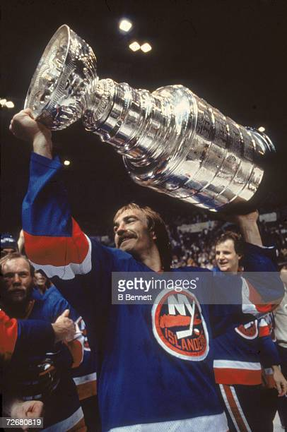 Swedish ice hockey player Bob Nystrom of the New York Islanders celebrates his team's third consectutive Stanley Cup victory by raising the cup...