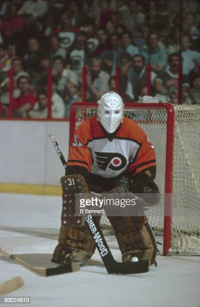 Swedish ice hockey player Pelle Lindbergh goalkeeper for the Philadelphia Flyers guards the net during a game early 1980s