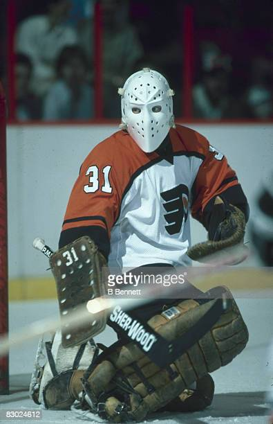 Swedish ice hockey player Pelle Lindbergh goalkeeper for the Philadelphia Flyers keeps an eye on the puck during a game early 1980s