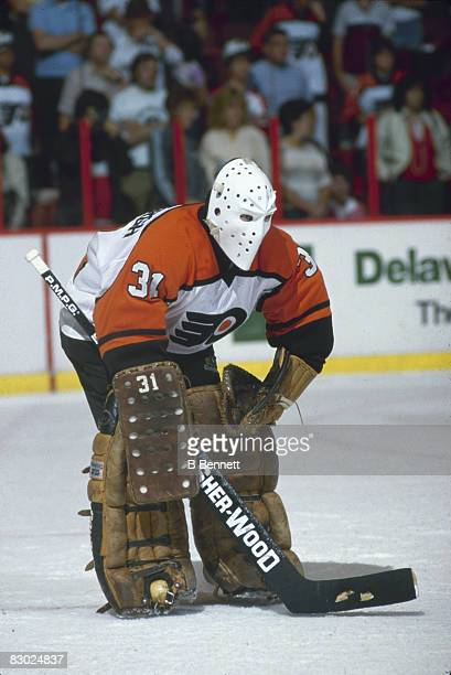 Swedish ice hockey player Pelle Lindbergh goalkeeper for the Philadelphia Flyers keeps an eye on the action during a game early 1980s