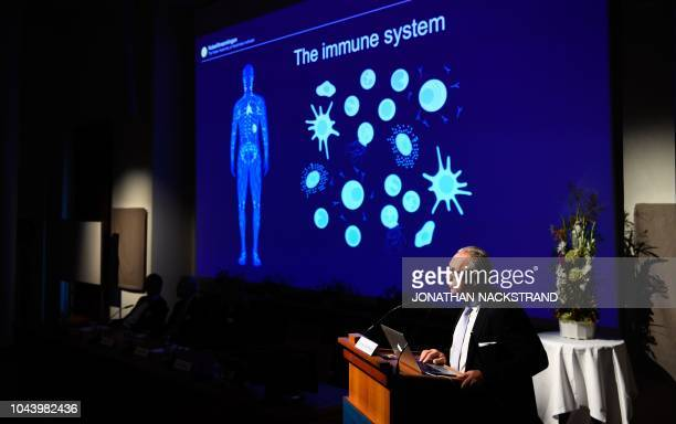 Swedish immunologist and member of the Nobel Committee for Physiology or Medicine Klas Kaerre gives explanations on the field of research of the...