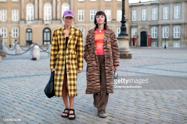 Swedish influencer Emma Fridsell, wearing a yellow checked coat by Baum und Pferdgarten, a black swimsuit, black sandals by Teva, a black bag and a...