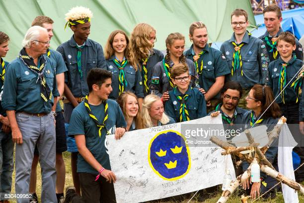 Swedish King Carl Gustav meets scouts from Norra Jaerva who have made a poster to their King with the royal Swedish symbol and the scouts name during...