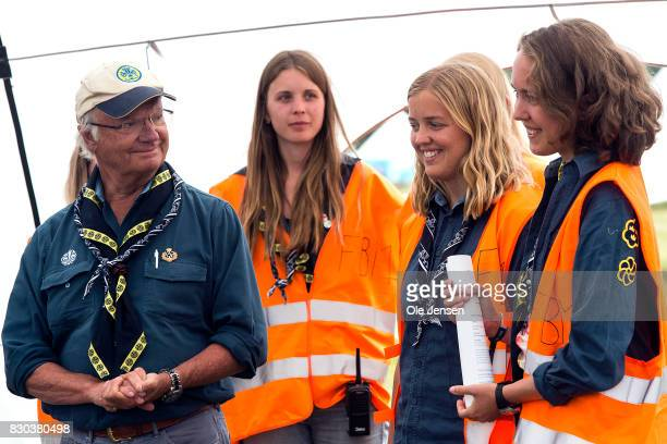 Swedish King Carl Gustav talks to scouts during his visit to the scouts jamboree on August 11 2017 in Kristianstad Sweden The King took a long tour...