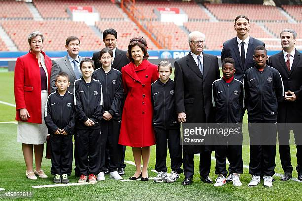 Swedish King Carl XVI Gustaf and Queen Silvia of Sweden pose for photographers with Swedish soccer player Zlatan Ibrahimovic and PSG President Nasser...