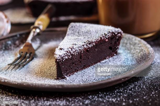 swedish kladdkaka, dark chocolate cake, swedish brownie, with coffee, close-up - icing sugar stock pictures, royalty-free photos & images