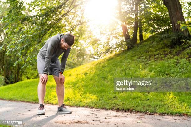 swedish man is exhausted after exercising in e public park - exaustão imagens e fotografias de stock