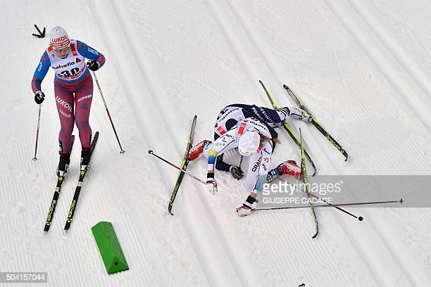 TOPSHOT Swedish Maria Rydqvist falls with Italian Lucia Scardoni next to Russian Alisa Zhambalova during the women's 10 km Mass Start classic...