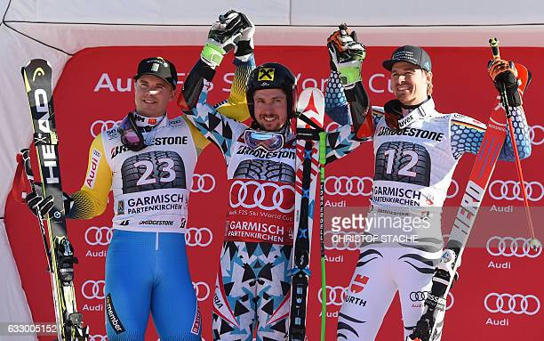 Swedish Matts Olsson Austrian Marcel Hirscher and German Stefan Luitz pose during the winner ceremony after the men giant slalom competition at the...