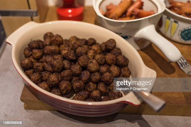 swedish meatballs (köttbullar) on julbord, christmas table, sweden - swedish culture stock pictures, royalty-free photos & images
