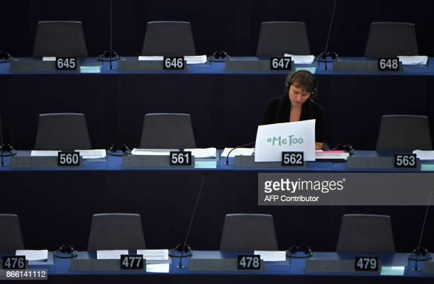 TOPSHOT Swedish MEP Linnéa Engström sits behind a placard placed on her desk that reads 'Me too' during a debate about combating sexual harassment...