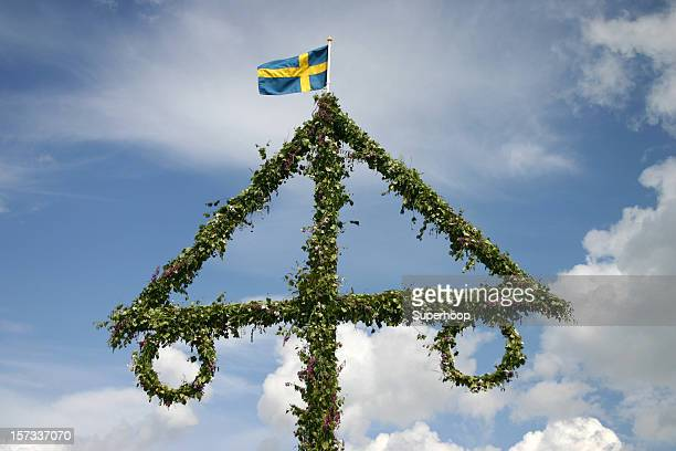 Swedish midsummer pole with typical weather