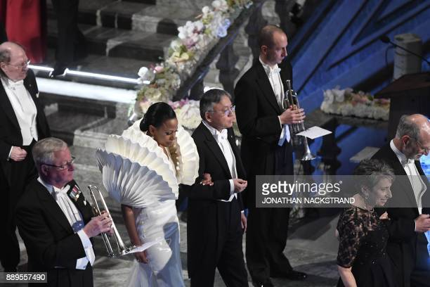 Swedish minister of culture Alice Bah Kuhnke and 2017 Nobel prize laureate in literature Kazuo Ishiguro arrive at the 2017 Nobel Banquet for the...