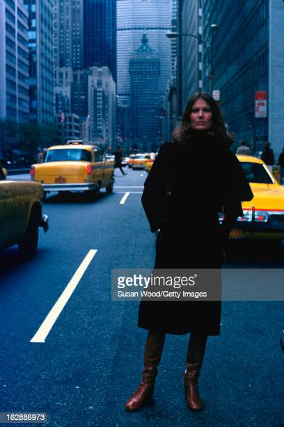 Swedish model and actress Maud Adams waits for a taxi on Park Avenue New York New York April 1975