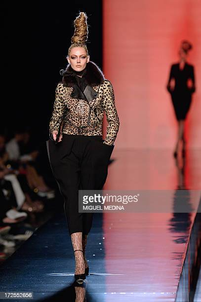Swedish model Frida Gustavsson presents a creation by Jean Paul Gaultier during the Haute Couture FallWinter 2013/2014 collection show on July 3 2013...