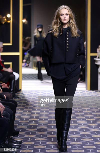 Swedish model Frida Gustavsson presents a creation for HM during the Fall/Winter 20132014 readytowear collection show on February 27 2013 at the...