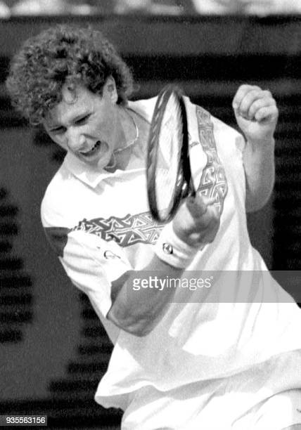 Swedish player Nicklas Kulti returns the ball with a forehand to his US opponent John McEnroe during the first round match of the French Open at the...