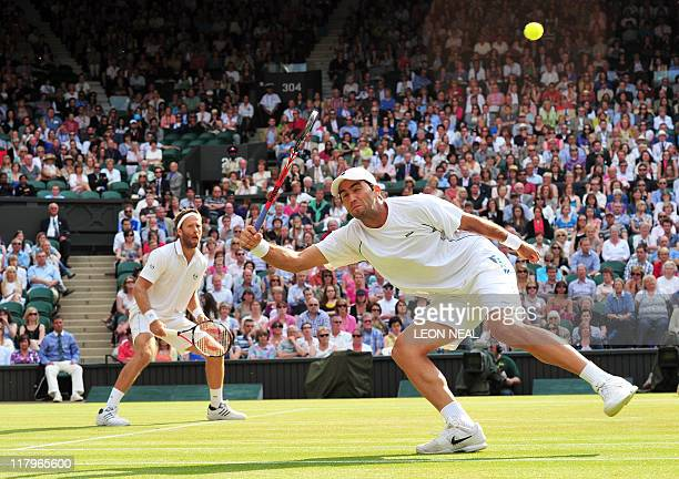 Swedish player Robert Lindstedt and Romanian player Horia Tecau play against US palyers Bob Bryan and Mike Bryan during Gentlemen's Doubles final at...