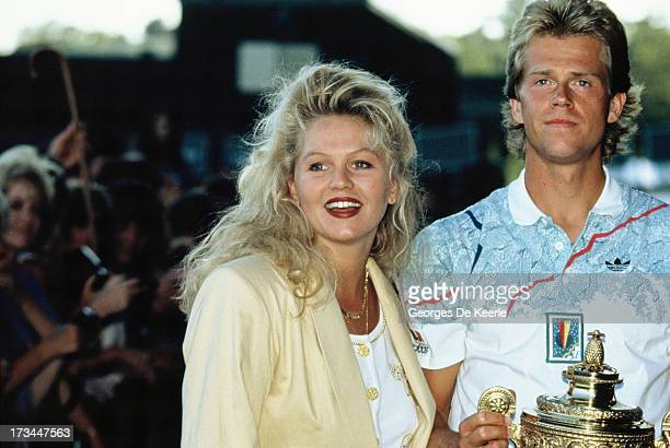 Swedish player Stefan Edberg and his girlfriend Annette Olsen pose with his trophy after winning the Men's Singles at the Wimbledon Championships on...