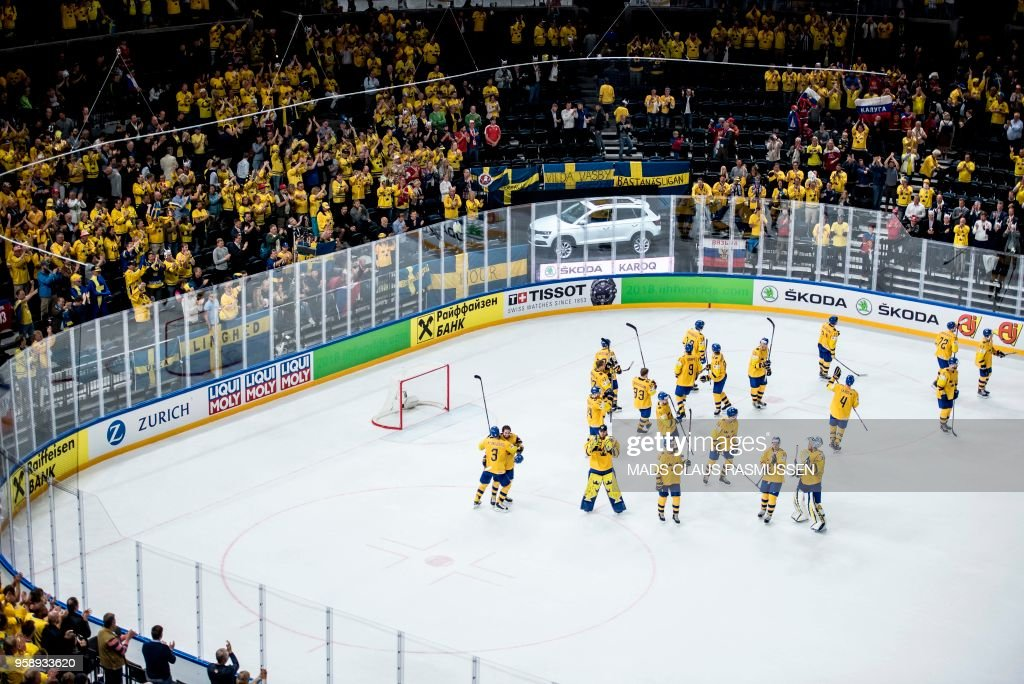 Swedish players celebrate after the IIHF World Championship group A ice hockey match between Russia and Sweden in Royal Arena in Copenhagen, on May 15, 2018. (Photo by Mads Claus Rasmussen / Ritzau Scanpix / AFP) / Denmark OUT