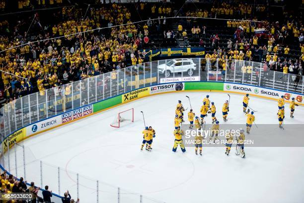 Swedish players celebrate after the IIHF World Championship group A ice hockey match between Russia and Sweden in Royal Arena in Copenhagen on May 15...