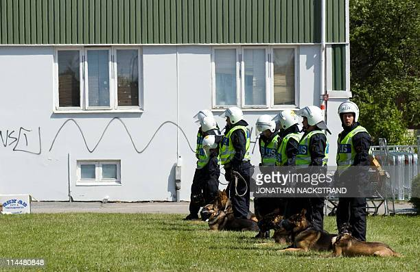 Swedish police dog force rests during a demonstration against and for the new Gothenburg mosque at Keillers Park in the city on May 21 2011...