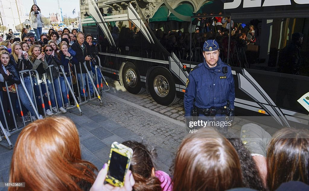 A Swedish police officer stands in front of the tour bus of Canadian pop singer Justin Bieber in Stockholm on April 23, 2013. A spokesperson for the Swedish police told AFP on April 25, 2013 that they had found a 'small amount' of drugs on Justin Bieber's tour bus in Stockholm, though no suspect has been identified.