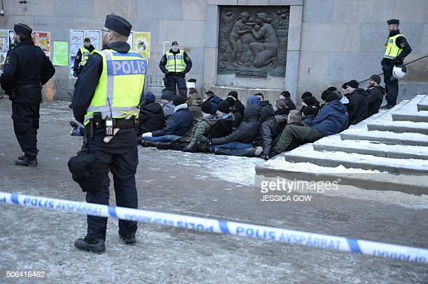 Swedish police surrounds an arrested group of neoNazis that staged an unannounced rally in Stockholm following a brawl on January 23 2016 AGENCY /...