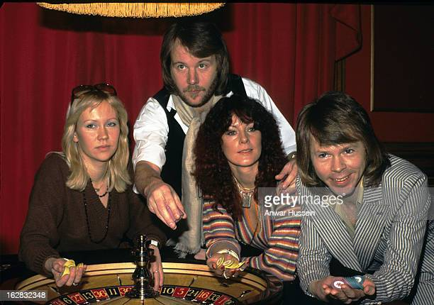 Swedish pop group Abba Agnetha Faltskog Benny Andersson AnniFrid Lyngstad and Bjorn Ulvaeus play roulette during a visit to London in 1974 in London...