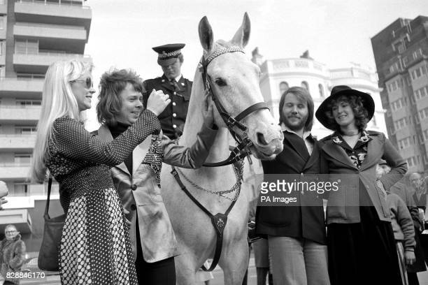 Swedish pop group Abba meet a mounted policeman as they relax in Brighton after their victory in the Eurovision Song Contest From left Agnetha...
