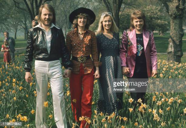 Swedish pop group Abba, winners of the 1974 Eurovision Song Contest at Brighton, strolling hand in hand amongst the daffodils in Hyde Park on April...