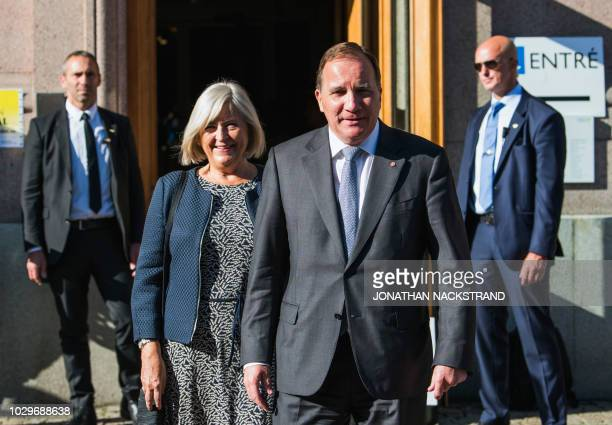 Swedish Prime Minister and leader of the Social Democratic party Stefan Lofven and his wife Ulla Lofven leave the polling station after voting in the...