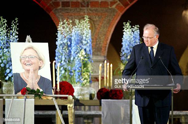 Swedish Prime Minister Goeran Persson glances at a portriat of slain Foreign Minister Anna Lindh while making a speech during the memorial service in...