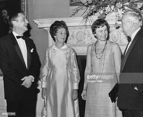 Swedish Prime Minister Olaf Palme and his wife talking to British Prime Minister Harold Wilson and his wife while attending a reception at 10 Downing...