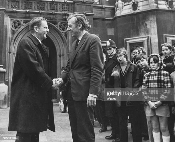 Swedish Prime Minister Olaf Palme shaking hands with Minister without Portfolio Peter Shore watched by a group of school children as they arrive at...